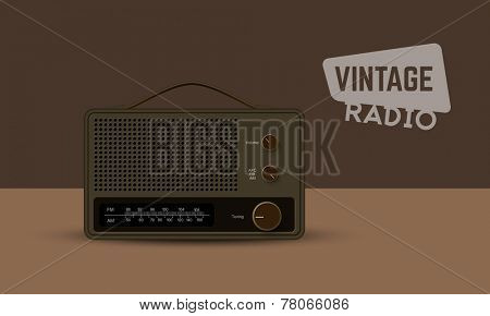 Vintage radio transistor isolated on brown background.