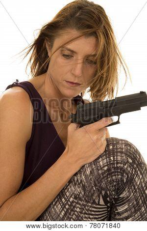 Woman In Tank Top Sit With Gun Hair Blowing Look Down