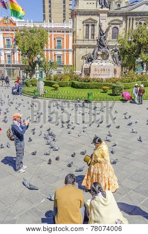 LA PAZ, BOLIVIA, MAY 8, 2014:  Local woman in traditional attire walks at Plaza Murillo