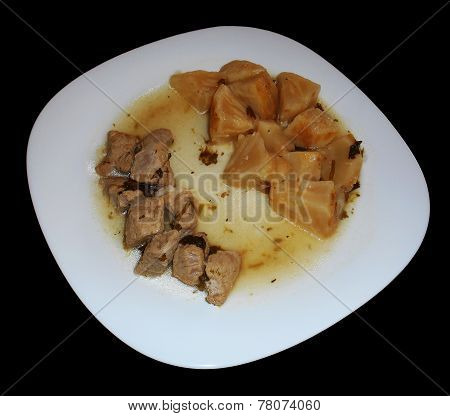 Pork with celeriac and potatoes isolated on black