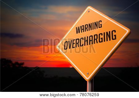 Overcharging on Warning Road Sign.
