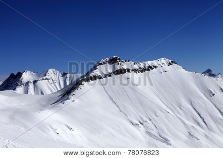 Off-piste Slope In Sun Day And Traces Of Avalanches