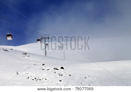 Gondola Lifts And Ski Slope In Mist