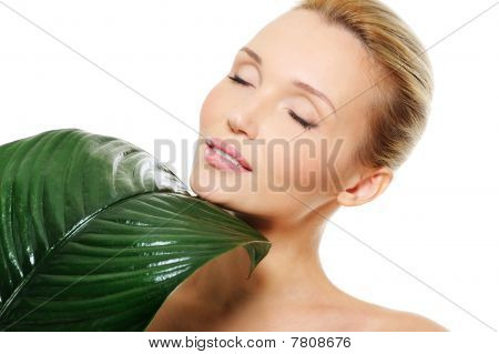 Face Of A Beautiful Cute  Woman With Large Green Leaf