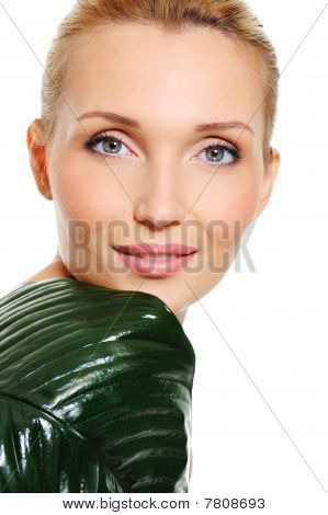 Healthy Face Of A Caucasian Woman With Green Leaf
