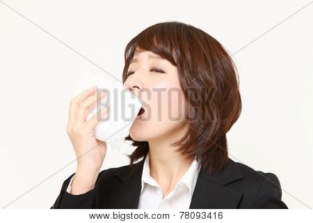 businesswoman with a allergy