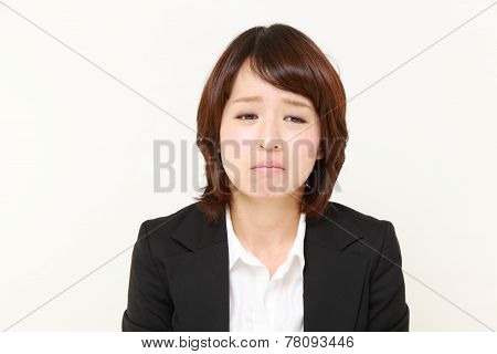 Japanese businesswoman cries