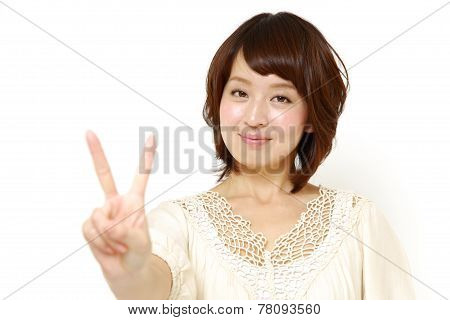 woman showing a victory sign