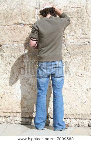 Man with Tefillin Praying at the Kotel