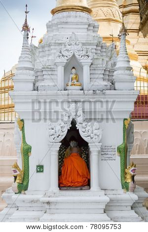 A Buddhist Monk Prays At Shwedagon Pagoda, In Yangon, Myanmar