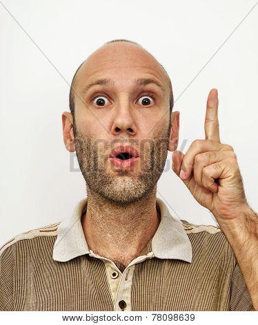 Amazed Man Showing Forefinger