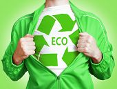 stock photo of open shirt breast showing  - Unrecognizable man wearing in shirt with green color eco recycling sign - JPG