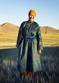 stock photo of mongolian  - Beautiful young Mongolian lady in the late afternoon sun - JPG