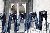 picture of clotheslines  - blue jeans on a clothesline to dry - JPG