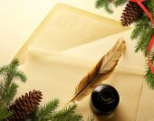 stock photo of inkwells  - Christmas decoration on envelope with inkwell and feather - JPG