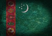 stock photo of turkmenistan  - Old rusty metal sign with a flag  - JPG