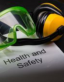 stock photo of goggles  - Health and safety register with goggles and earphones
