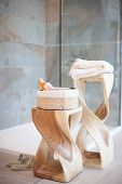 image of housecoat  - Bathrobes shampoo and soap on wooden shelves - JPG