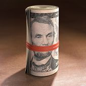 foto of gag  - Money roll with elastic gagging the mouth of Abraham Lincoln - JPG