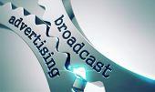 stock photo of cogwheel  - Broadcast Advertising on the Mechanism of Metal Cogwheels - JPG
