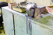 foto of locksmith  - vice and parts on table in locksmith workshop - JPG