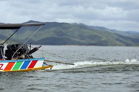 picture of outboard  - Outboard motor running on the local boat - JPG