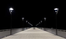 picture of lamp post  - Night view of a wooden pier and lamp posts - JPG