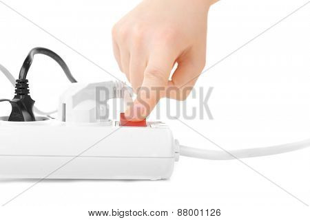 woman hand turn on switch on extension cord isolated on white