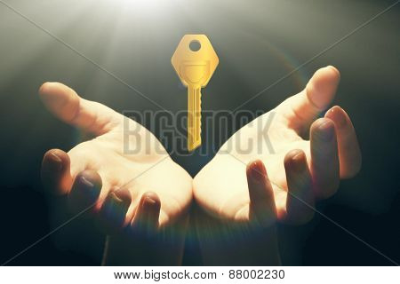 Female hands with key on dark background