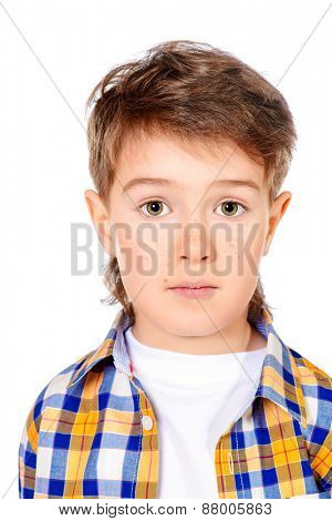 Portrait of a cute 7 year old boy. Copy space. Isolated over white.