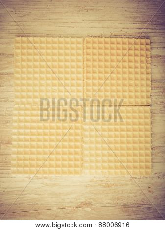 Vintage Photo Of Wafers On White Wooden Table