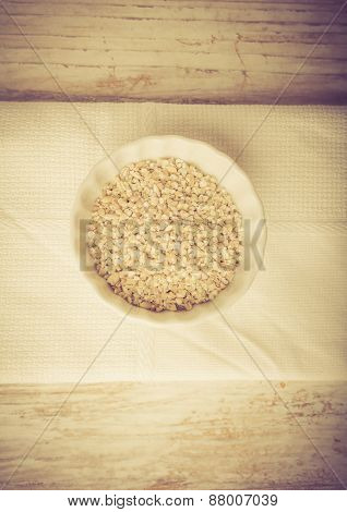 Barley Groats In Bowl On A White Wood. Vintage Photo