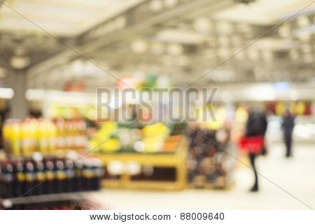 Supermarket Store Blur Background With Bokeh And Blurred Customer Choosing Product To Buy