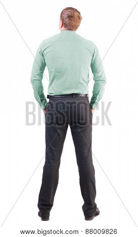 back view of business man  in red shirt looks ahead.Rear view people collection.  backside view of person.  Isolated over white background. office worker with a sports figure looks away