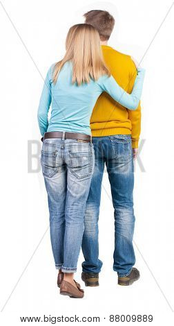 Back view young embracing couple (man and woman) hug and look into the distance. beautiful friendly girl and guy Rear view people collection.  backside view of person.  Isolated over white background.