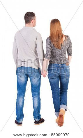 Back view of young embracing couple hug and look into the distance. beautiful friendly girl and guy together. Rear view people collection.  backside view of person.  Isolated over white background.