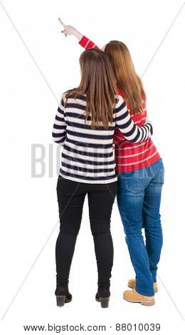 Two long haired friendly women pointing .  backside view of person. Isolated over white background. Rear view people collection.