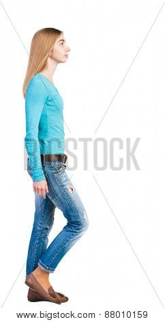 side view of walking  woman in jeans. beautiful blonde girl in motion.  backside view of person.  Rear view people collection. Isolated over white background.