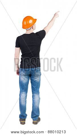 Back view of  pointing young men in  t-shirt and helmet. Young guy  gesture. Rear view people collection.  backside view of person.  Isolated over white background.