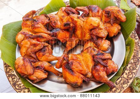 Baked Fried Chicken Carcass On Metal Plate