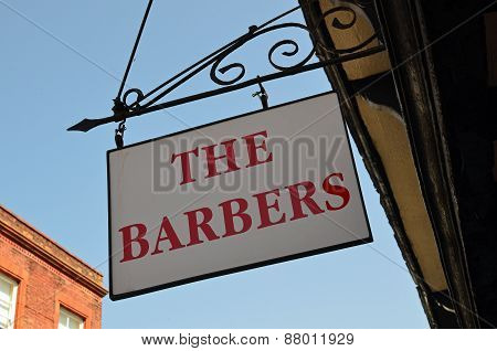 Barbers hairdressers shop sign