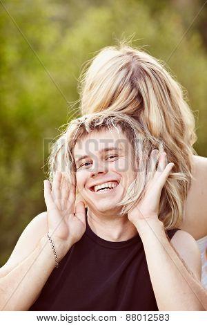 Man trying on long hair