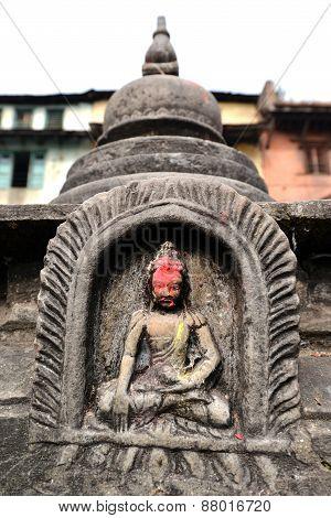 Stone Statuette Of Sitting Buddha In Swayambhunath. Nepal