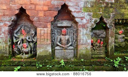 Statues Of Hindu Deities On A Public Monument. Bhaktapur, Nepal