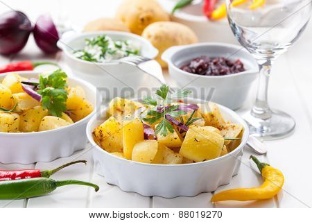 Baked potatoes with chutney and sour cream