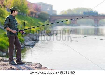 Fisher on a river