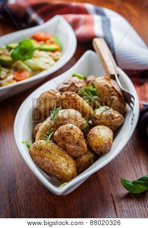 Oven baked potatoes with cabbage salad