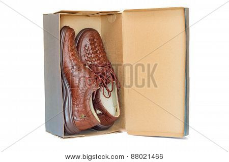 Men's Shoes In The Package On A White Background.