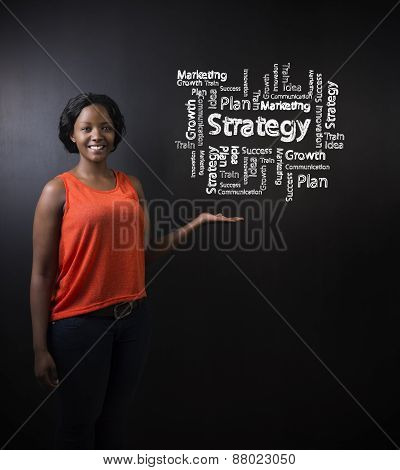South African Or African American Woman Teacher Or Student Against Blackboard Strategy Diagram