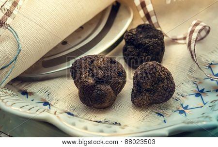 Mushrooms Black Truffle On A Plate